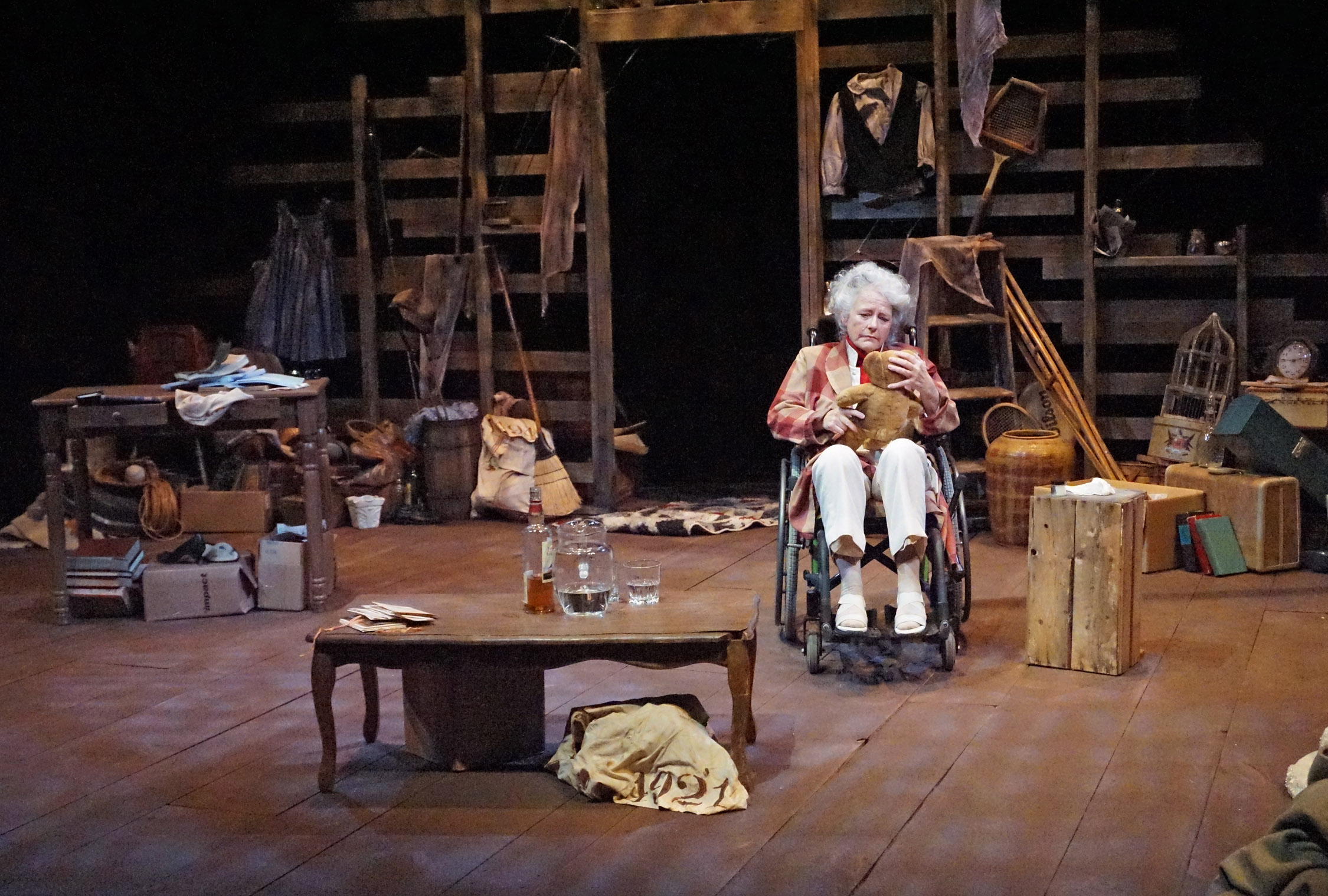 janis stephens with teddy bear as Kate Hepburn, full stage view from LNT's current production