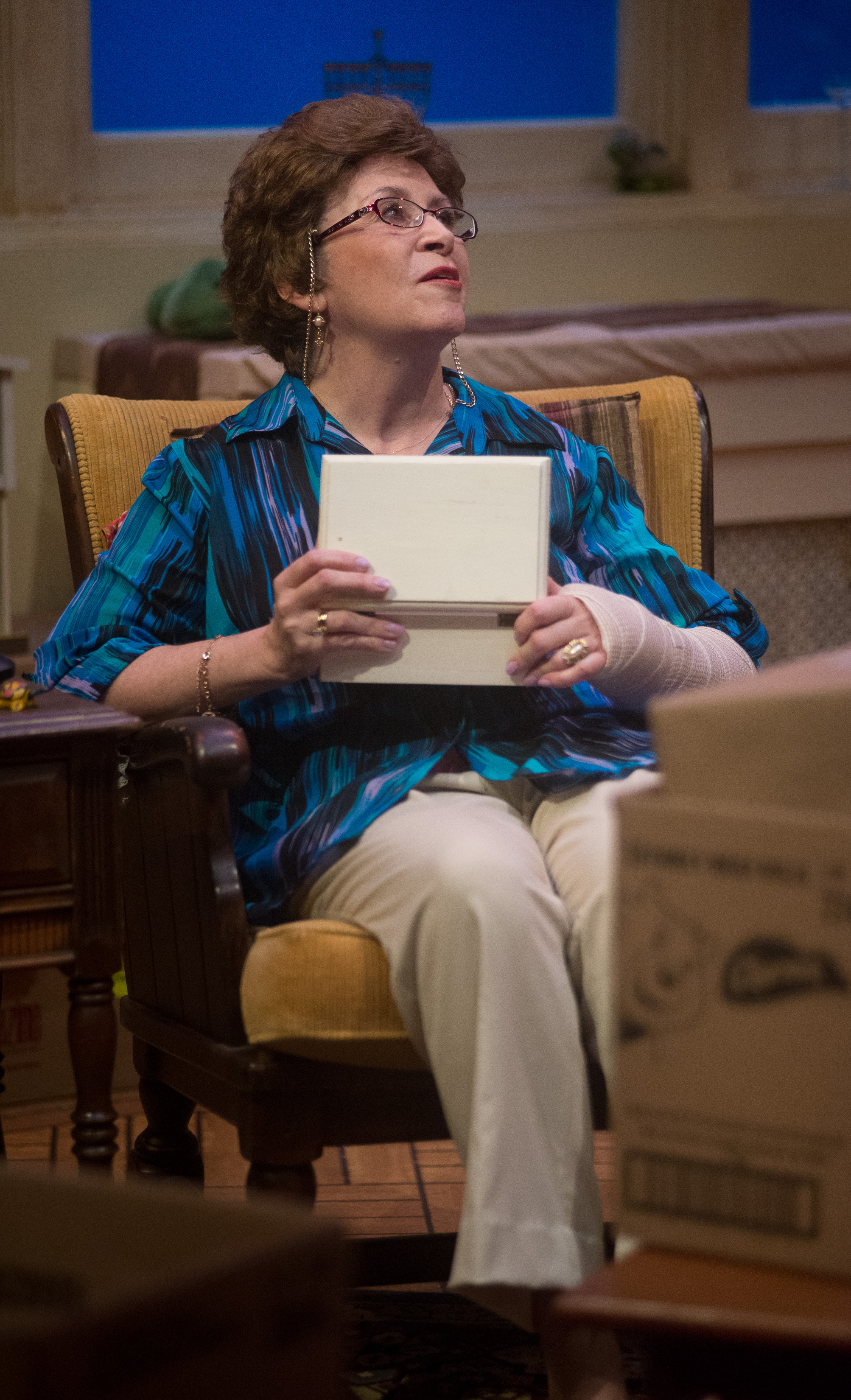 Maura O'Brien holds a music box to her chest remembering a childhood lullabye. photo courtesy of Robert Eddy