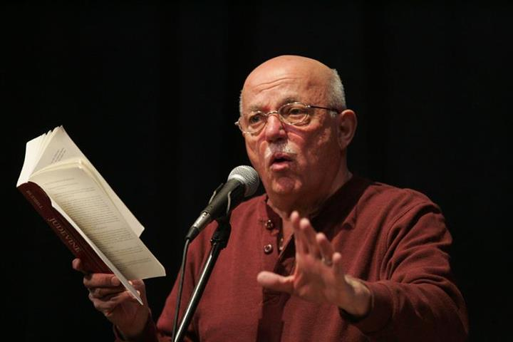 portrait of david budbill in a reading performance